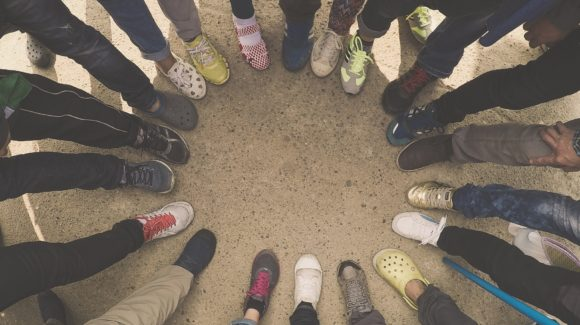 different feet and shoes in a circle